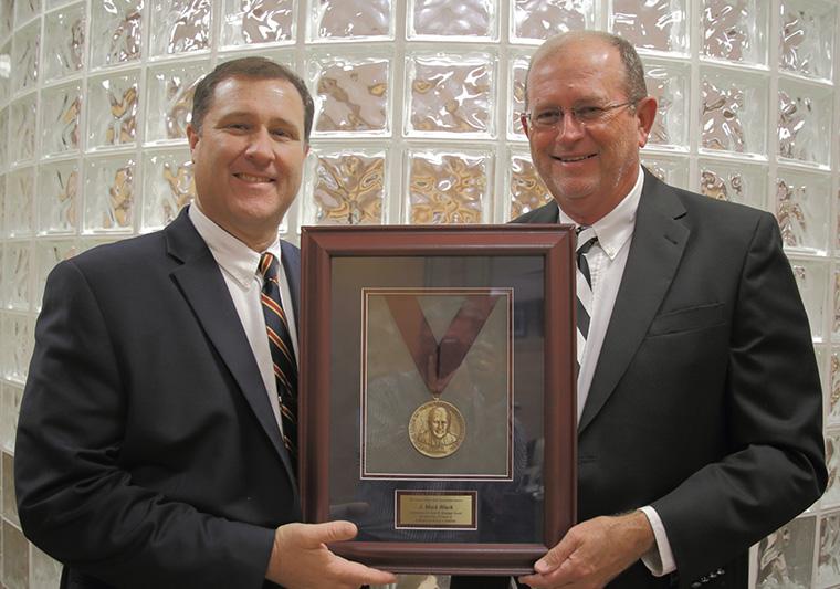 Todd Lowe presenting the Ike Granger Award to J. Mark Black